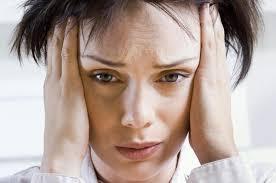 dejected woman, head in hands