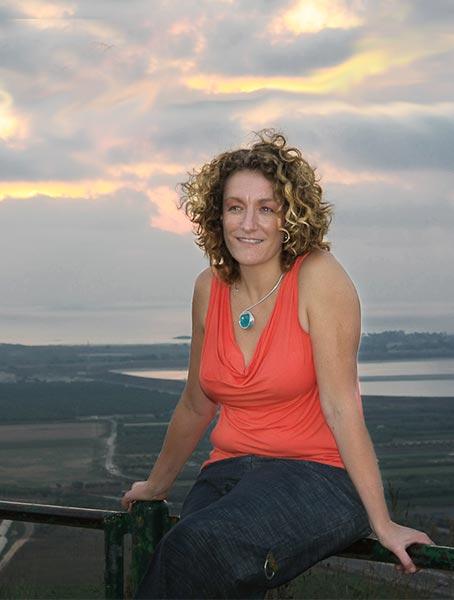 Lisa Bloom seated on railing