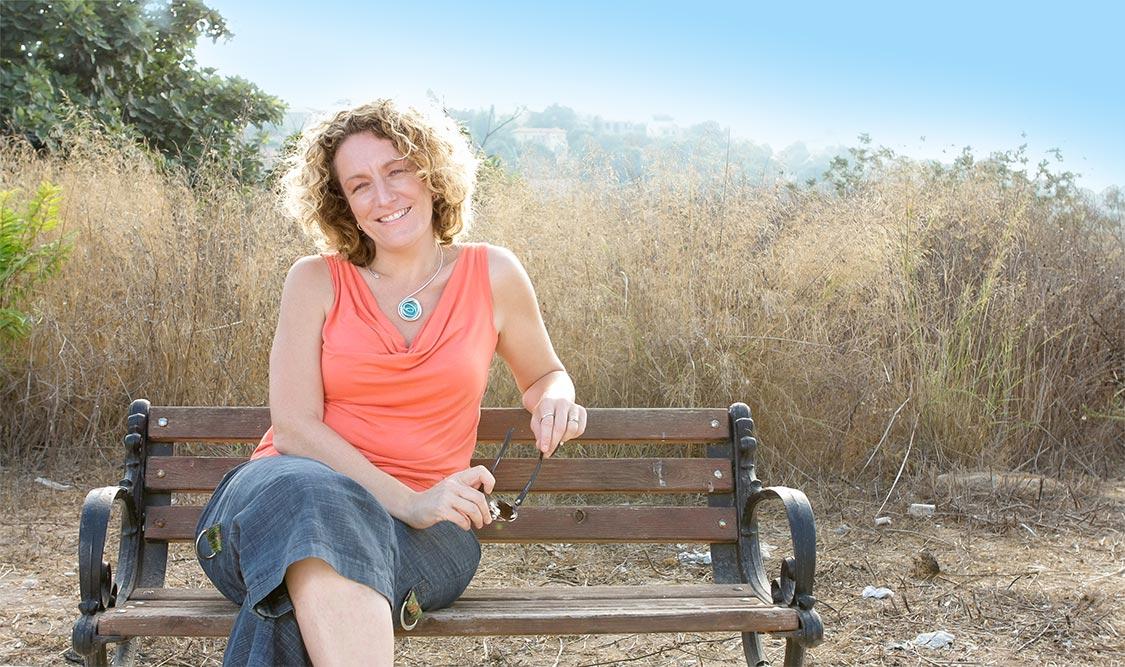 Meet Lisa Bloom, sitting on park bench