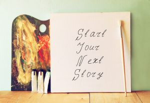canvas with the phrase start your next story next to oil paints
